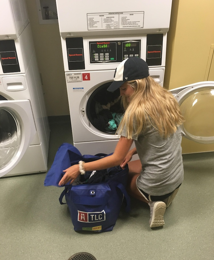 A student Laundry Processor at work on the Pitt campus.